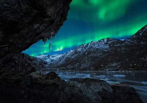 Aurora-seen-from-a-cave-in-Norway