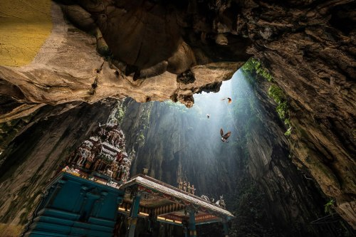 Birds-sunlight-and-a-temple-inside-Batu-Caves-in-Malaysia