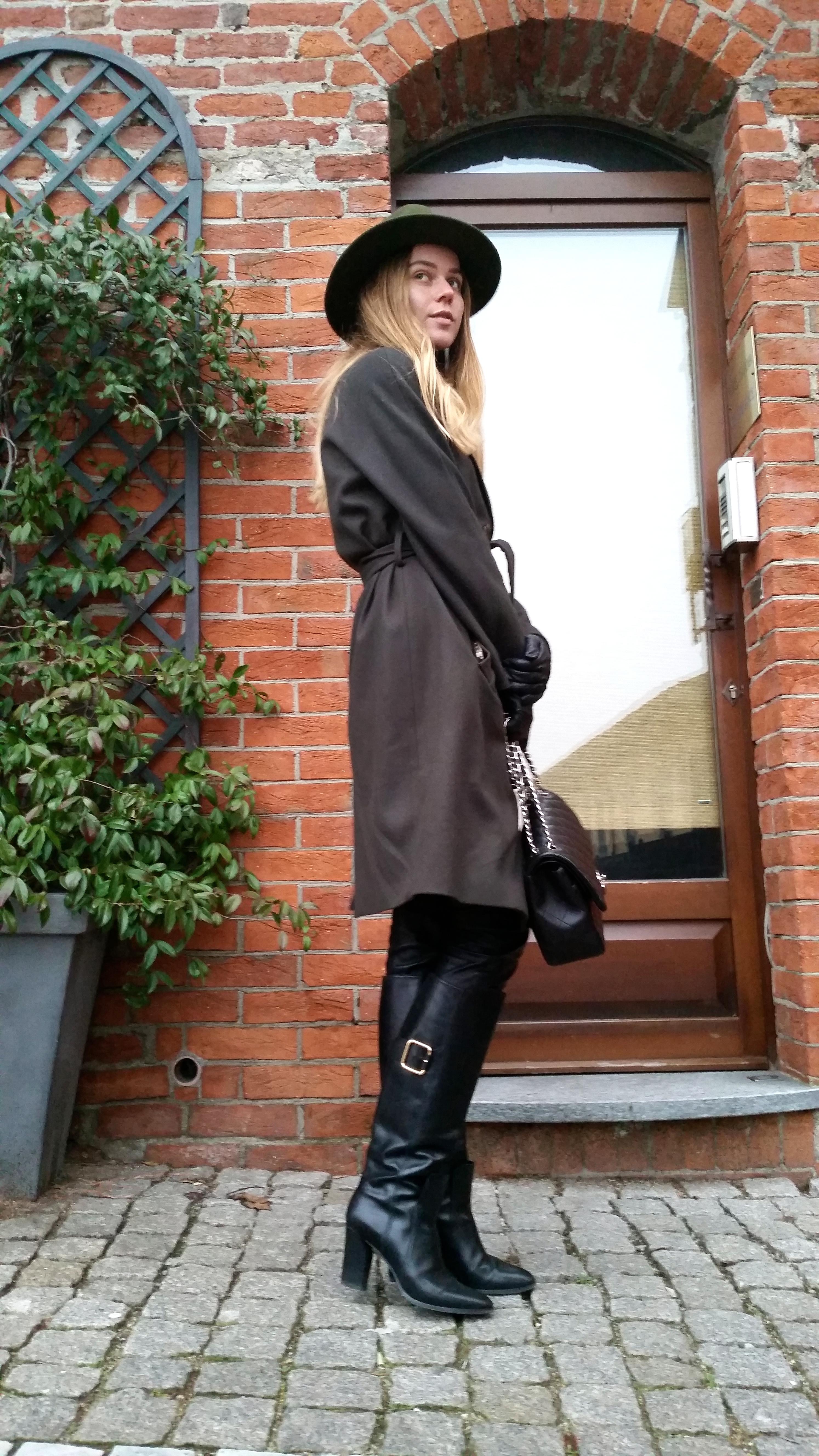 svetlana shashkova being Italian in double breast khaki coat
