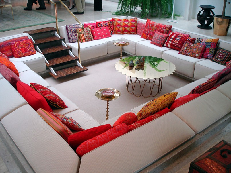 living-room-with-lower-floor-designs-and-beautiful-valentine-day-decor-with-red-pillows-and-luxury-table-and-modern-stairs-also-round-glass-table-with-freestanding-glass-table