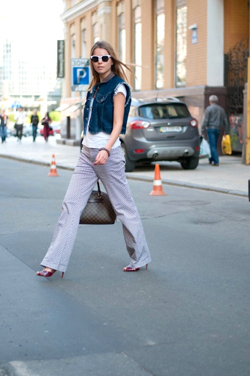 walking in geometric patterns mixed with a jeans vest