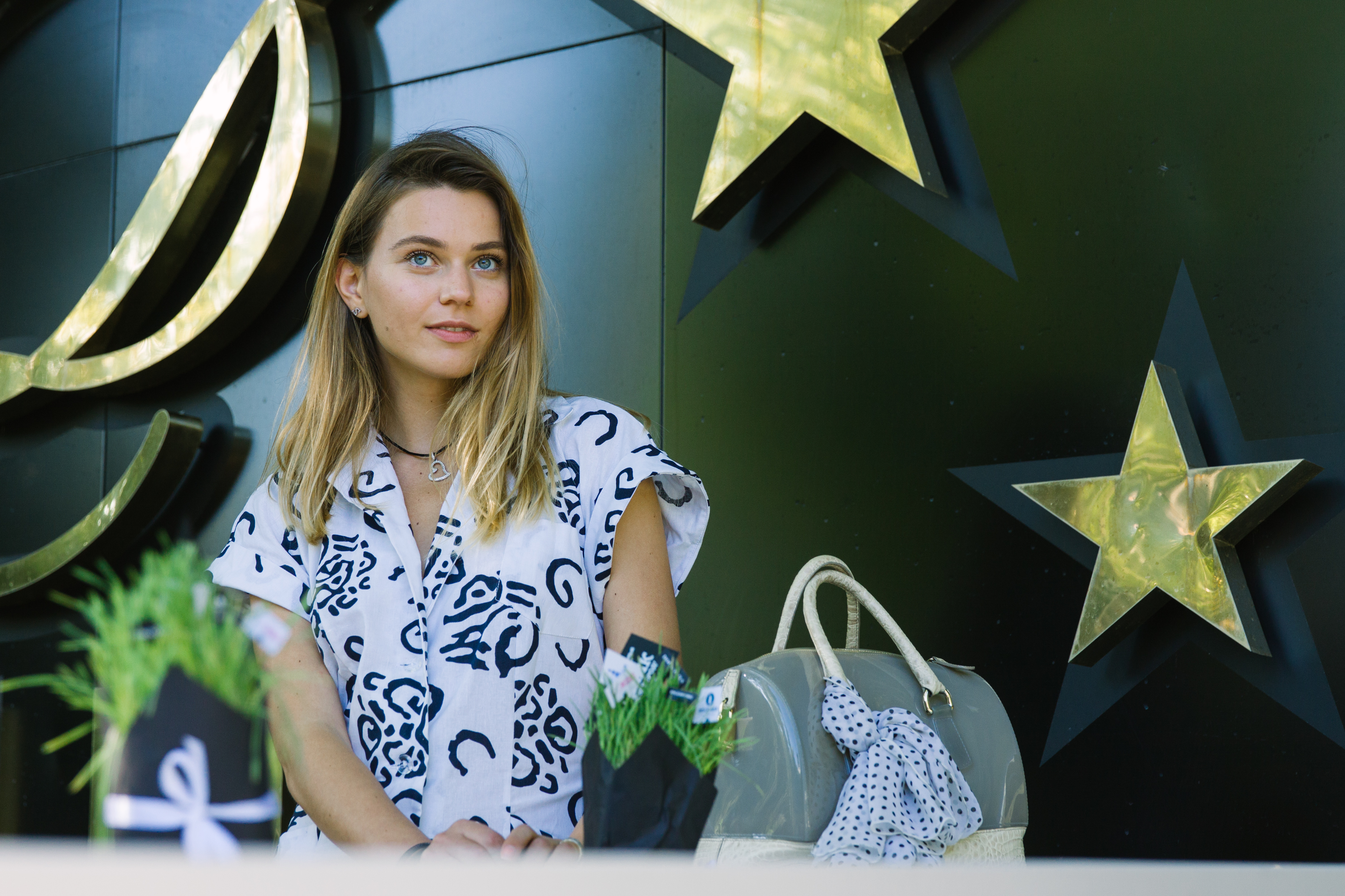 svetlana shashkova on the picnic with furla bag