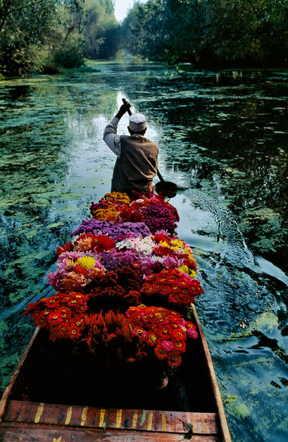 INDIA. Jammu and Kashmir. Srinagar. 1999. Flower Seller at Dal Lake.